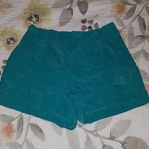 H & M DIVIDED peacock colored shorts